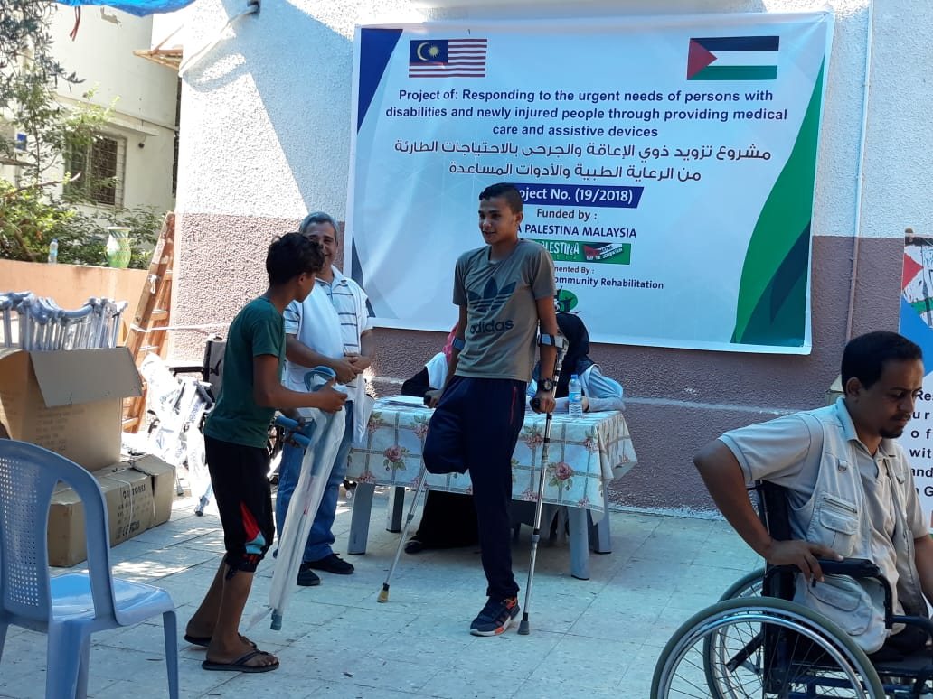 NCCR DISTRIBUTE ASSISTIVE DEVICES FUNDED BY VIVA PALESTINA MALAYSIA
